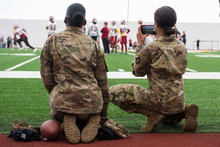 Soldiers with the 3d U.S. Infantry Regiment (The Old Guard) watch players of the Washington Redskins practice during the Salute to Service Day, at the Inova Sports Performance Center at Redskins Park on May 24, 2017 in Ashburn, Virginia. Salute to Service Day recognized approximately 150 active service members and veterans at the exclusive event presented by United Services Automobile Association. (U.S. Army photos by Sgt. Nicholas T. Holmes)