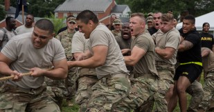 Soldiers from the 3d U.S. Infantry Regiment (The Old Guard) and Marines from Joint Base Myer-Henderson Hall competed against each other in a tug-of-war challenge during the 4th annual Urban Warrior Challenge 22 June, 2017. The competition brings the Army and Marines together in games and challenges that help build team cohesion, camaraderie and offers something to do for the whole family. (U.S. Army Photo by Sgt. George Huley)