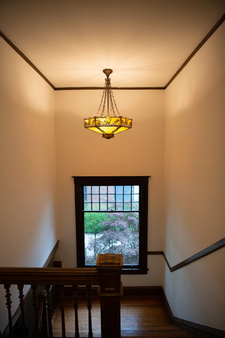 The old Tiffany chandelier looks great in the stair landing of our Howard Van Doren Shaw home in La Grange,il
