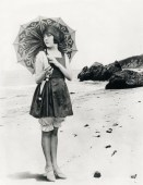 1920s beach fashion - Sunbathing was an absolute new activity of the 1920s. Although the benefits of sunlight was discovered at the end of the 1800s, only in the 1920s, when doing sports became popular, getting a tan became fashionable