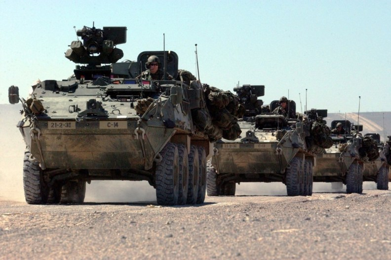 A Column Of Stryker Combat Vehicles
