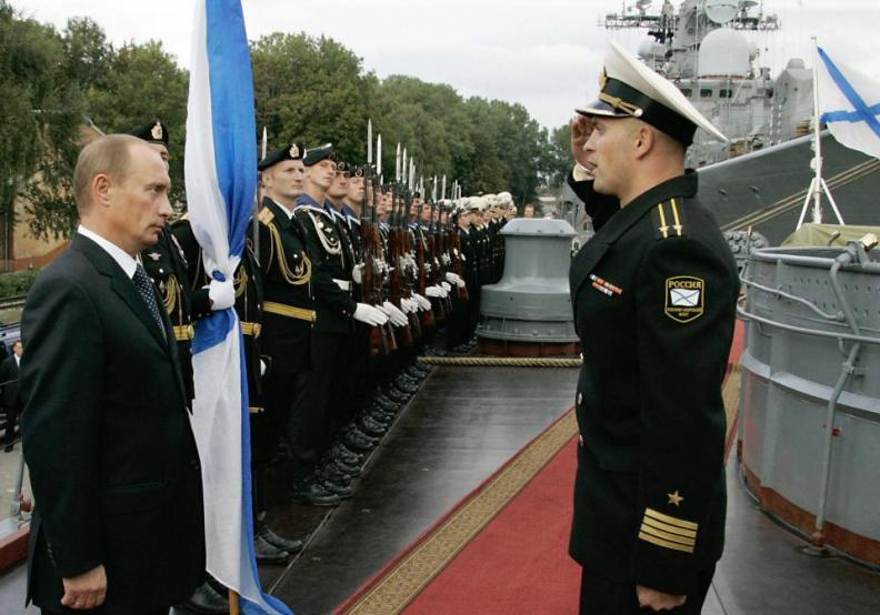 "Kaliningrad, RUSSIAN FEDERATION: Russian President Vladimir Putin (L) listens to a report of a captain of the destroyer ""Nastoichivy"", the Baltic Fleet flagship, during his visit to the town of Baltiisk outside Kaliningrad, the Russian westernmost region, 10 September 2006. AFP PHOTO / ITAR-TASS POOL / PRESIDENTIAL PRESS SERVICE (Photo credit should read SERGEI ZHUKOV/AFP/Getty Images)"