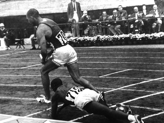 Ulis Williams stumbles in the 4X400 relay finals_The Olympic Century - XVIII Olympiad - Volume 16