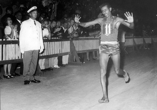 Abebe Bikila winning gold in the marathon in Rome in 1960.