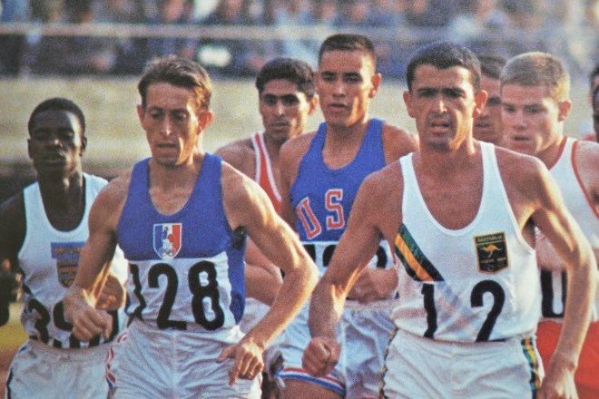 Billy Mills (middle) and Ron Clarke (right) in 10000 meter run, from the book,