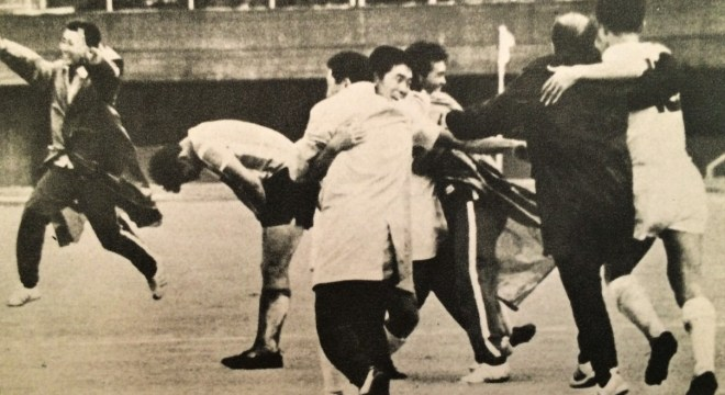 "Japan beats Argentina with Coach Cramer on the right in black, from the book ""Tokyo Olympiad 1964, Kyodo News Agency"""