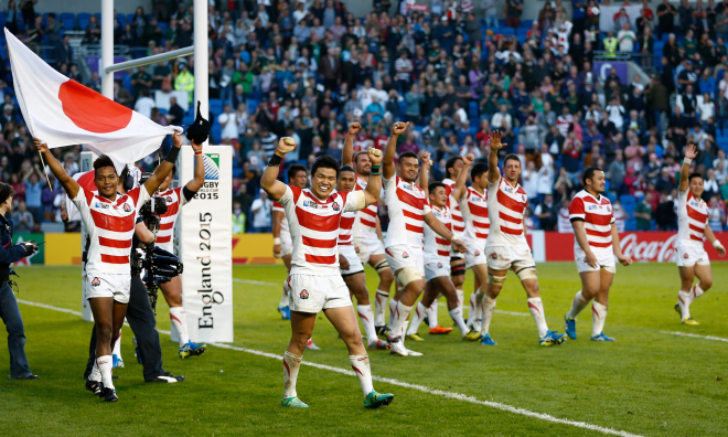 Japan react to their suprise victory over South Africa in their opening game of the 2015 Rugby World Cup. Photograph: Julian Finney/Getty Images