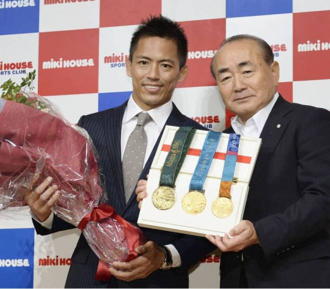 Tadahiro Nomura with His Three Gold Medals