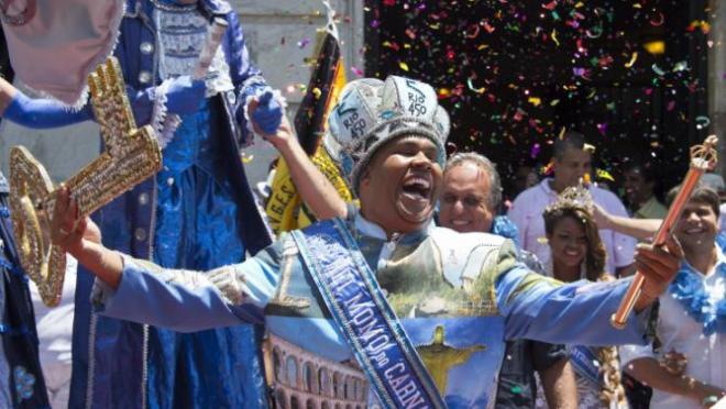 Carnival King Momo, Wilson Dias da Costa Neto, celebrates upon receiving the keys to the city