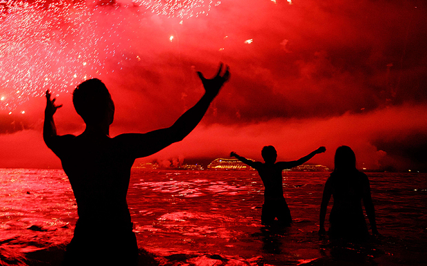 People watch fireworks during New Years