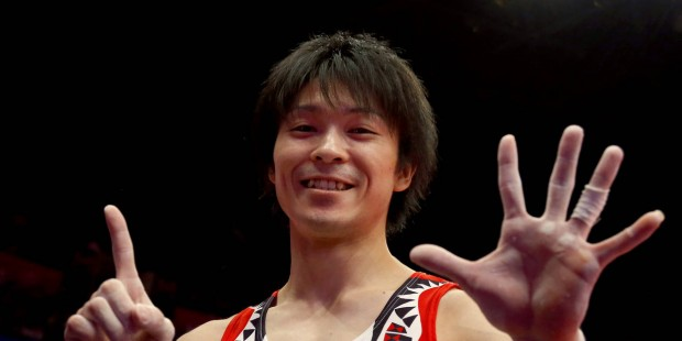 Uchimura holds up six fingers