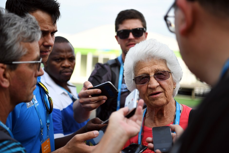 Ans Botha, coach for South African sprinter Wayde van Niekerk, talks to reporters during media availability at the Olympic Village in Rio de Janeiro.