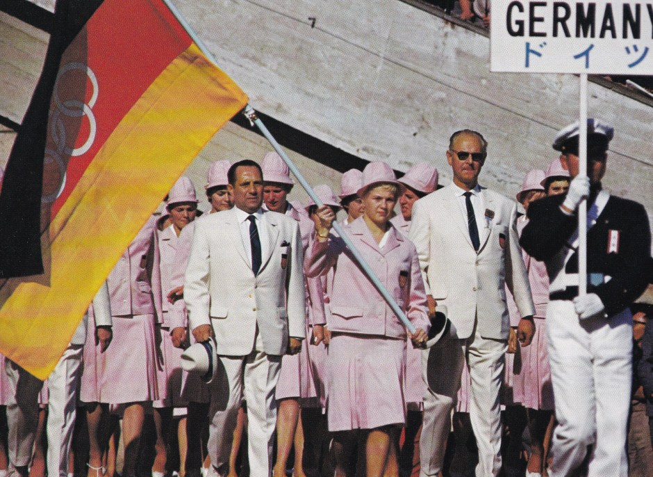 ingrid-engel-kraemer-carries-the-unified-german-teams-olympic-banner-at-1964-tokyo-olympics_the-olympic-century-the-xviii-olympiad