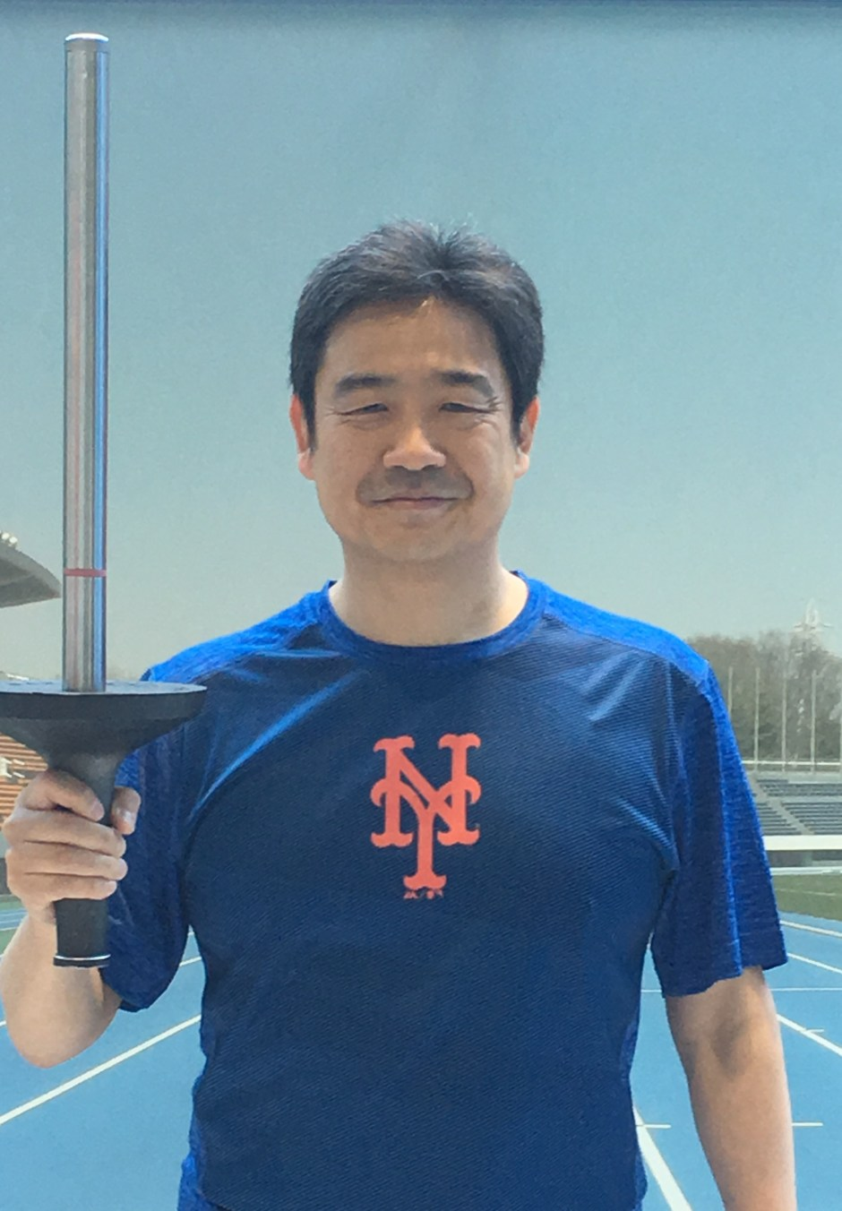 Roy with 1964 Tokyo Olympic Torch