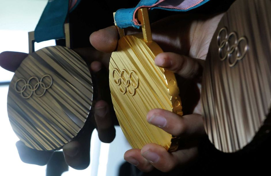 PyeongChang Olympic medals held by hands
