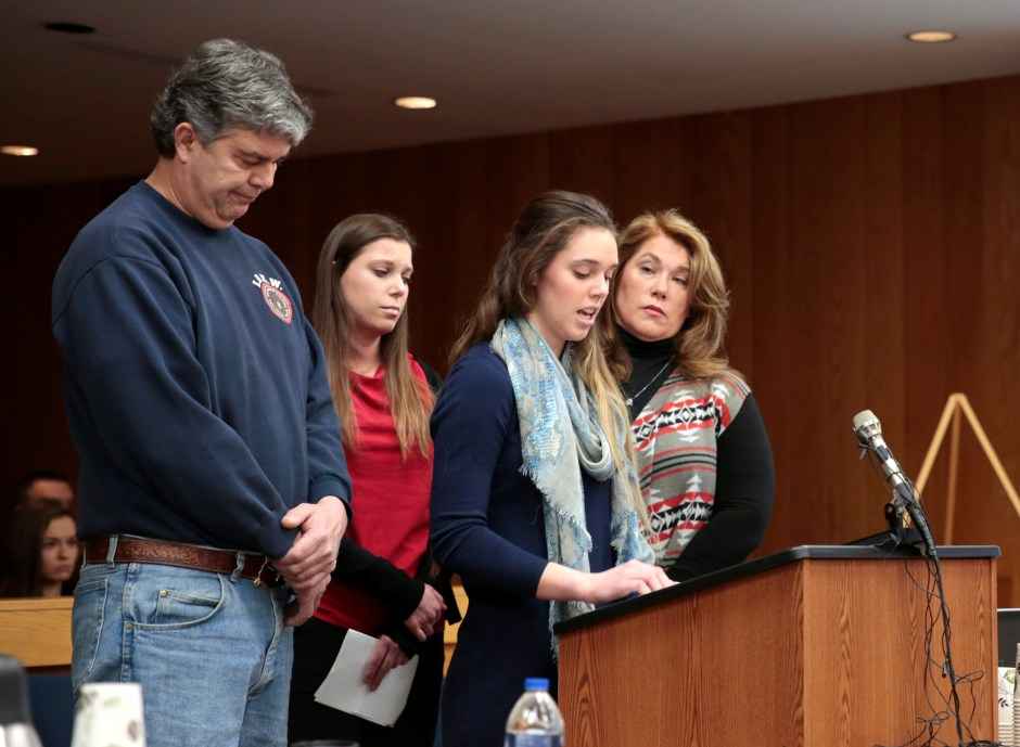 Madison Rae Margraves gives her impact statement as her parents and sister Lauren listen during the sentencing hearing for Larry Nassar, in the Eaton County Court in Charlotte