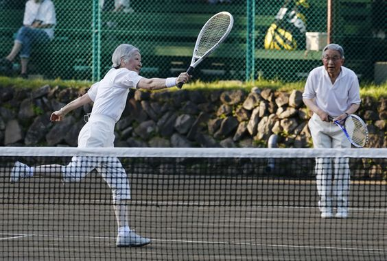 Elderly Akihito and Michiko playing tennis