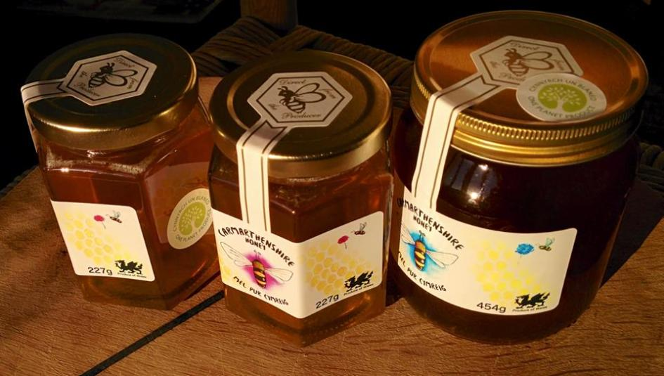 honey jars with one planet produce label
