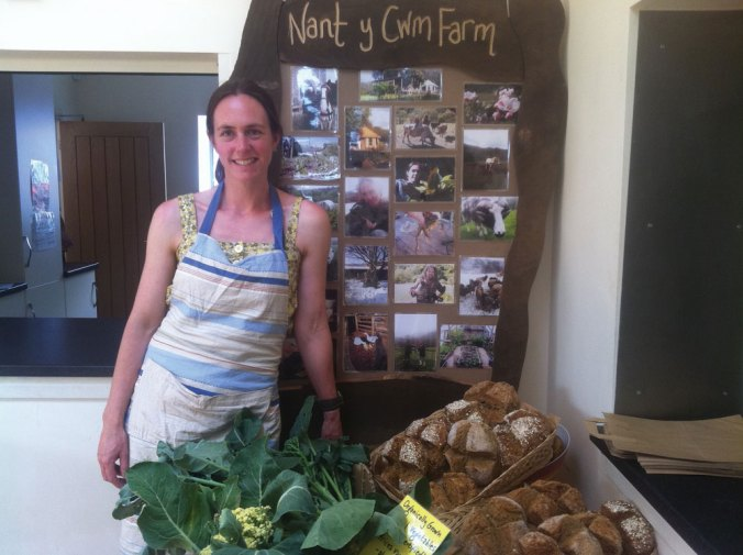 Sarah Moody selling produce from Nant-y-Cwm One Planet Development