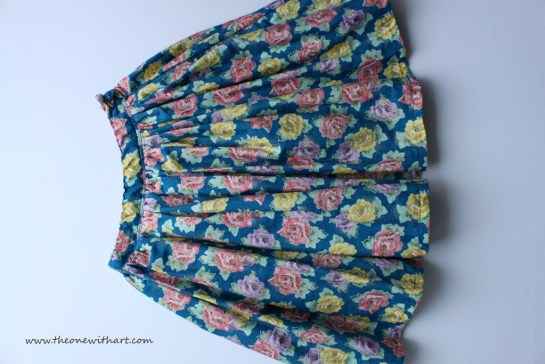 blue and flowers skirt logo