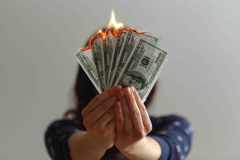Woman burning Dollar Bills