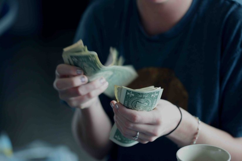 Woman counting Academic Writing Money