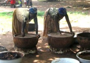 Women working the oil out for shea butter -theonlywayisghana