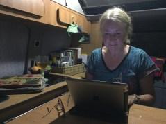 Working on iPad in campervan