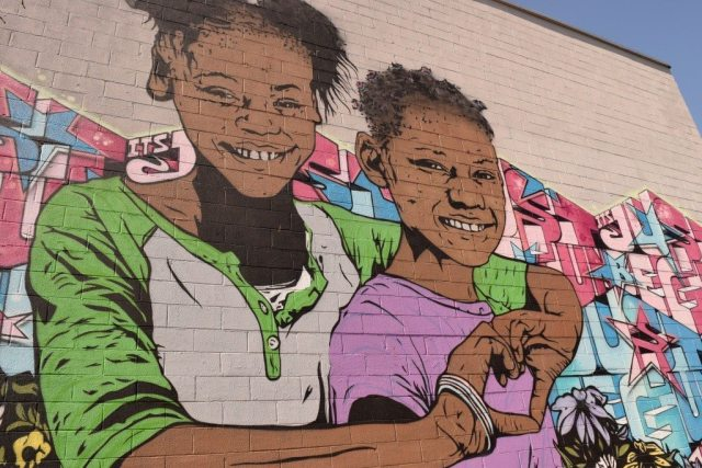 mural of two sisters in the Bushwick Collective