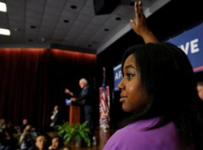 FILE PHOTO: Garner raises her hand to ask U.S. Democratic presidential candidate Sanders a question in Columbia