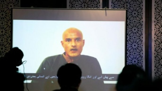 Former Indian navy officer Kulbhushan Sudhir Jadhav is seen on a screen during a news conference at the Ministry of Foreign Affairs in Islamabad
