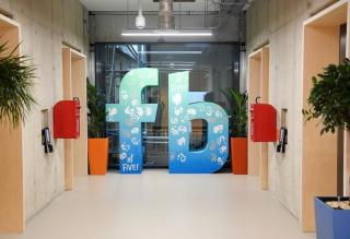 A large logo is seen at Facebook's headquarters in London