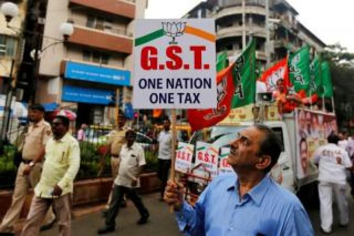 FILE PHOTO: A supporter of India's ruling Bharatiya Janata Party holds a placard during a rally to support implementation of GST in Mumbai