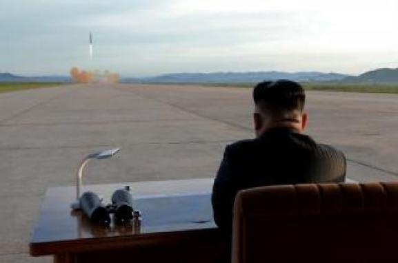 FILE PHOTO: North Korean leader Kim Jong Un watches the launch of a Hwasong-12 missile