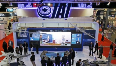 Visitors watch a demonstration at the Israel Aerospace Industries (IAI) booth in the IMDEX Asia maritime defence exhibition in Singapore