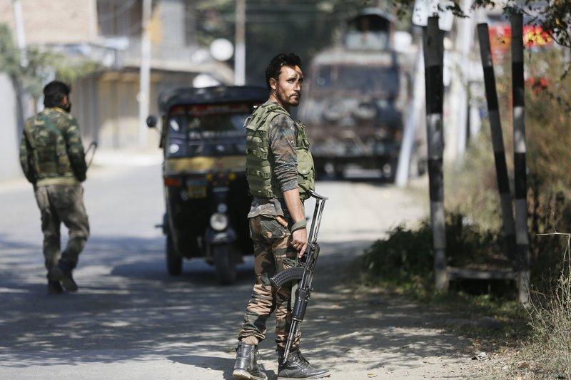 police man standing in Kashmir-AP