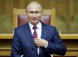 Russian President Putin attends a session of the Eurasian Women's Forum in St. Petersburg