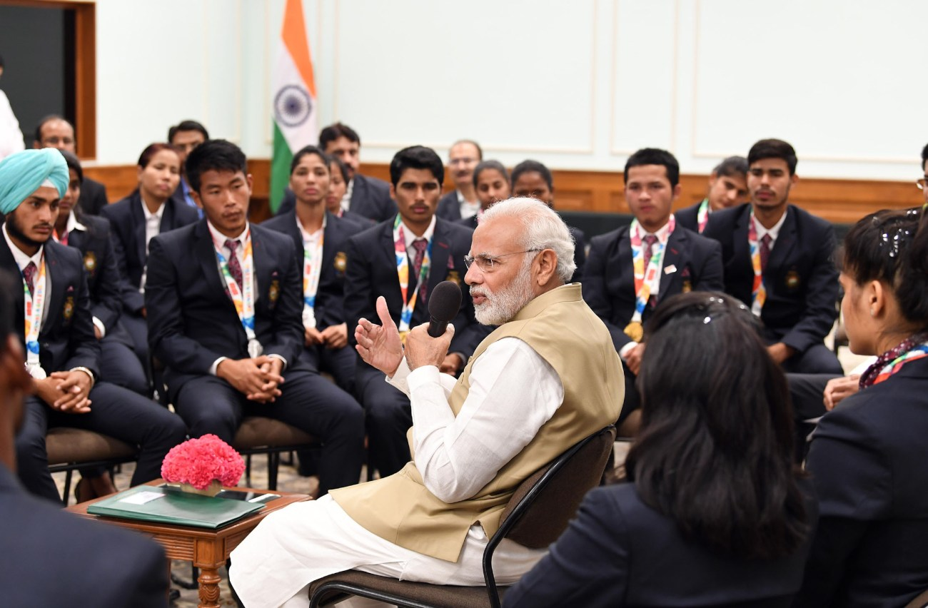 The Prime Minister, Shri Narendra Modi interacting with the medal winners of the 2018 Summer Youth Olympics, held in Argentina, in Delhi on October 21, 2018.-pib