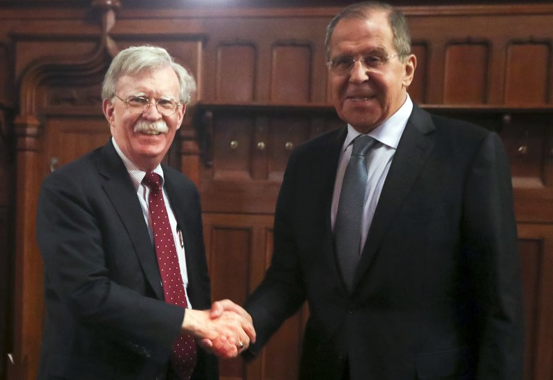 US National security advisor John Bolton left and Russian foreign minister Sergey Lavrov shake hands in Moscow-AP
