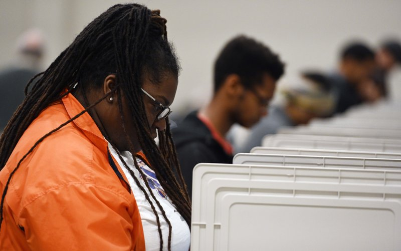 People cast their ballots ahead of the Nov 5 general election at Jim Miller Park