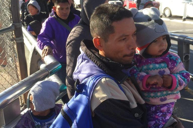 Cold-weather-drives-migrants-camped-at-border-bridge-into-shelter