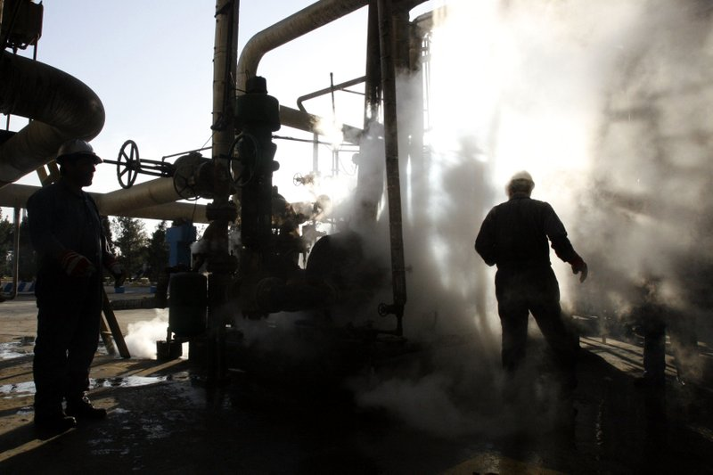 A worker repairs a part of a unit of the Tehran oil refinery in Tehran on Nov 17, 2007-AP