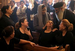 Mourners gather at Prince Tadros Church for the funeral of Coptic Christians who were killed in an attack, in Minya