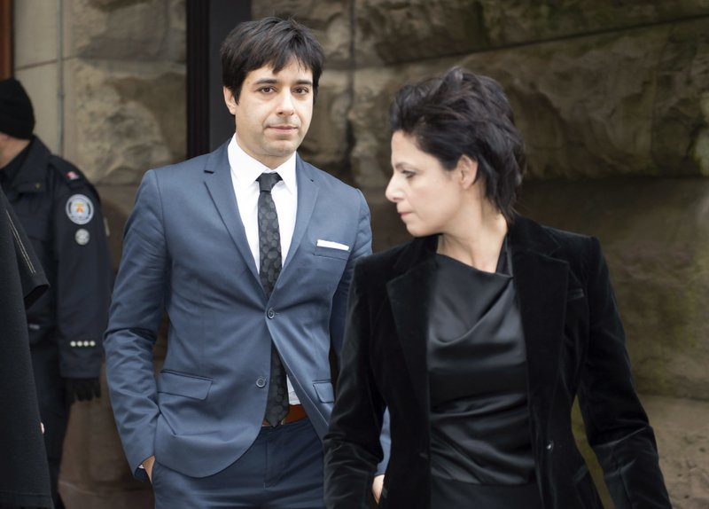 FILE - In this March 24, 2016 file photo, Jian Ghomeshi leaves court in Toronto with his lawyer Marie Henein after he was acquitted on all charges of sexual assault and choking-AP