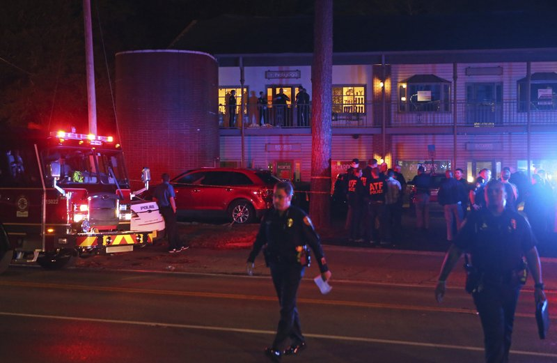 Police investigators work the scene of shooting in Tallahasses, Florida-AP