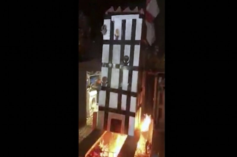 Tuesday Nov 6, 2018, people place a model of Grenfell Towers onto a bonfire in London-AP