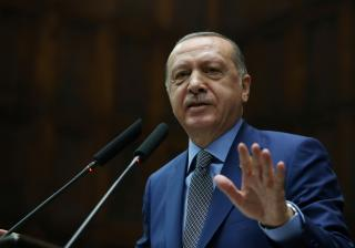 Turkish President Tayyip Erdogan addresses members of parliament from his ruling AK Party during a meeting at the Turkish parliament in Ankara