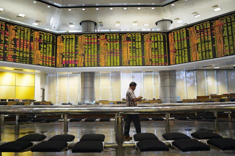 Asian shares mixed as officials mum on China-US trade talks- AP