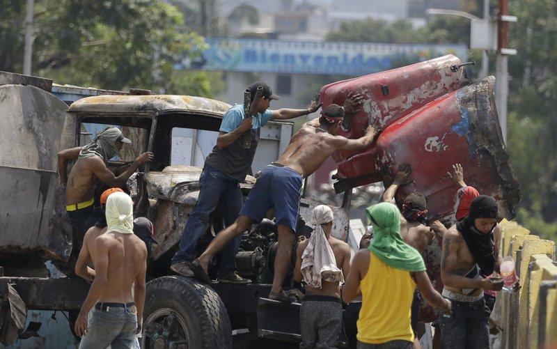 Maduro opponents boost military rhetoric in Venezuela crisis