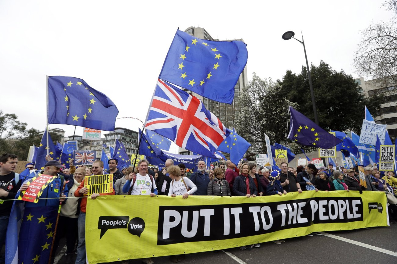 Demonstrators hold a banner during a Peoples Vote anti-Brexit march in London
